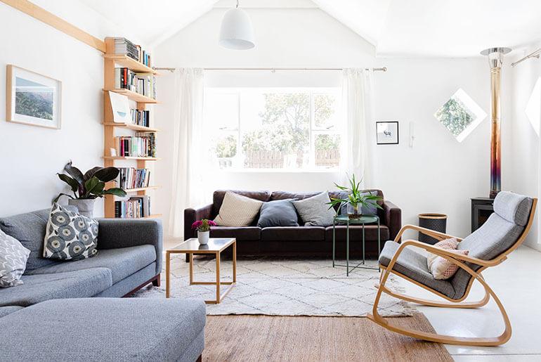 bookshelf between two sofas