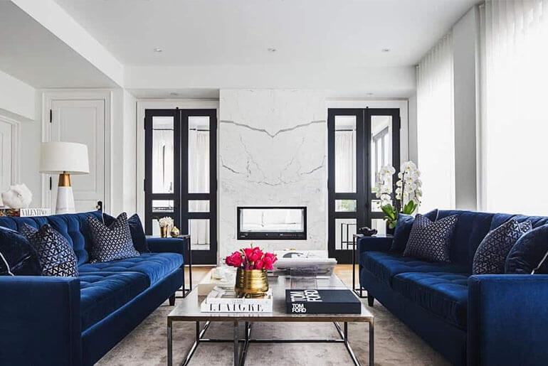 living room with two blue velvet sofas