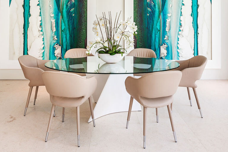 Contemporary Dining Room with beige bucket chairs and glass table