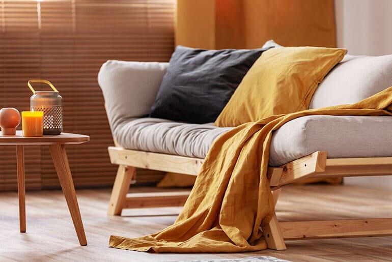 make futon more comfortable