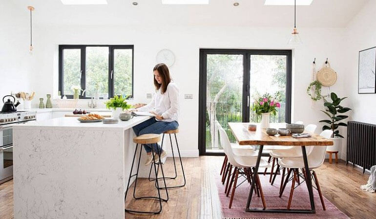 mismatched bar stools and dining chairs