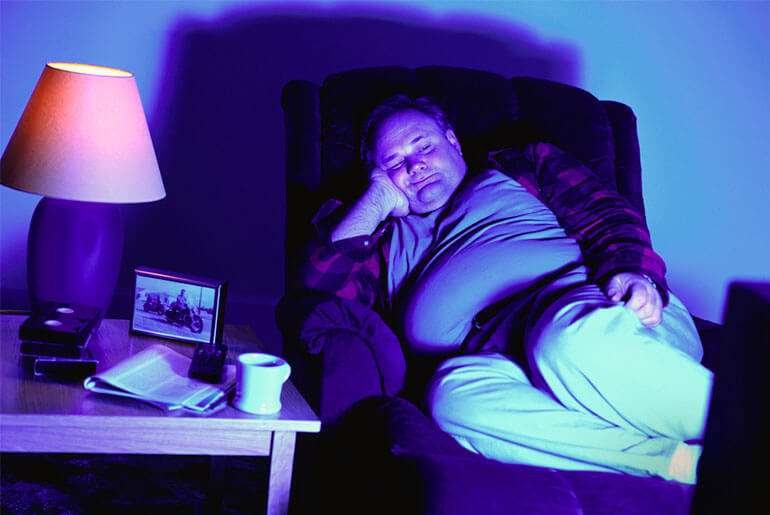 overweight man sitting in recliner